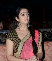 charmi-saree-stills-at-potugadu-audio-launch-13
