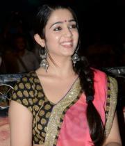 charmi-saree-stills-at-potugadu-audio-launch-15