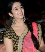 charmi-saree-stills-at-potugadu-audio-launch-16