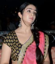 charmi-saree-stills-at-potugadu-audio-launch-19