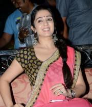 charmi-saree-stills-at-potugadu-audio-launch-2