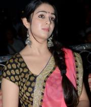 charmi-saree-stills-at-potugadu-audio-launch-21