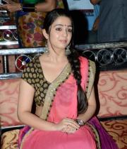 charmi-saree-stills-at-potugadu-audio-launch-24