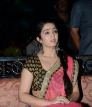 charmi-saree-stills-at-potugadu-audio-launch-25