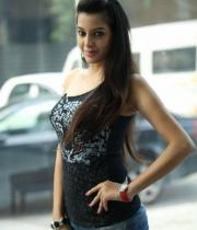 deeksha-panth-hot-stills-in-black-dress-10