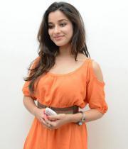 madhurima-new-stills-in-orange-dress-01