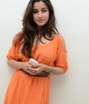 madhurima-new-stills-in-orange-dress-03