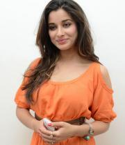 madhurima-new-stills-in-orange-dress-06