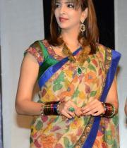 manchu-lakshmi-saree-stills-at-potugadu-audio-launch-1
