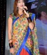 manchu-lakshmi-saree-stills-at-potugadu-audio-launch-10