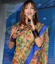 manchu-lakshmi-saree-stills-at-potugadu-audio-launch-11