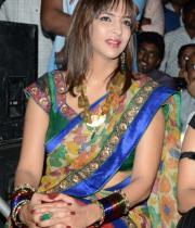 manchu-lakshmi-saree-stills-at-potugadu-audio-launch-12