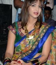 manchu-lakshmi-saree-stills-at-potugadu-audio-launch-13