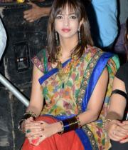 manchu-lakshmi-saree-stills-at-potugadu-audio-launch-14