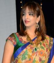 manchu-lakshmi-saree-stills-at-potugadu-audio-launch-15