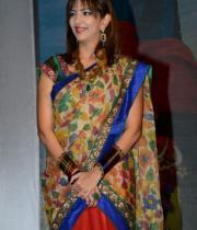 manchu-lakshmi-saree-stills-at-potugadu-audio-launch-2