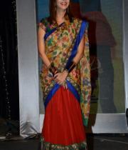 manchu-lakshmi-saree-stills-at-potugadu-audio-launch-3