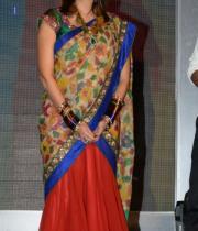 manchu-lakshmi-saree-stills-at-potugadu-audio-launch-6